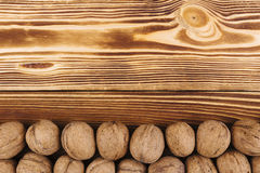 Walnut on the wooden background Stock Images