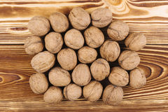 Walnut on the wooden background Stock Photos
