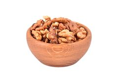 Walnut in wooden bowl Stock Image