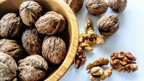 Walnuts in a wooden bowl stock photography