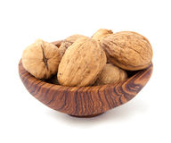 Walnut in the wooden plate Royalty Free Stock Images
