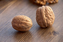 Walnuts on the wooden-table. Royalty Free Stock Photos