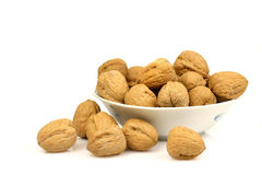 Walnuts. Bowl with a bunch of walnuts Stock Images