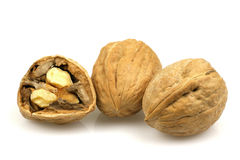 Walnuts. Bunch of walnuts with one cracked walnut Royalty Free Stock Image