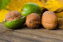 Walnuts. Autumn walnuts on wooden background Stock Photo