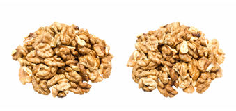 Walnuts. Cracked walnuts cores with more nuts as background Royalty Free Stock Photos