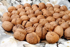Walnuts. Lots of walnuts on christmas background Royalty Free Stock Photography
