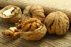 Walnuts. On old wooden board Royalty Free Stock Photography