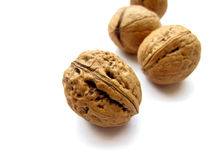 Walnuts. Some whole walnuts isolated on white background Stock Photo