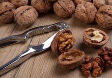 Walnuts. Group of walnuts on old wooden table Royalty Free Stock Images