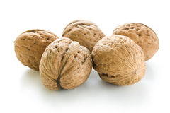 Walnuts. Arrangement of five whole walnuts close-up  on white background Royalty Free Stock Image