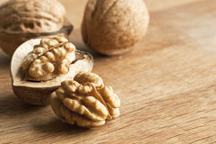 Walnuts. A macro view of fresh walnuts on a wooden surface Royalty Free Stock Images