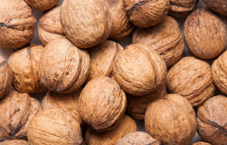 Walnuts. Stacked in the market place Royalty Free Stock Photography