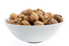 Walnuts. Bowl with walnuts on white background Stock Photo
