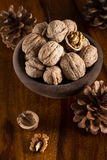 Walnuts. Autumn still life with walnuts on wooden table Royalty Free Stock Image
