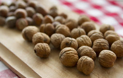Walnuts. Group of walnuts lying on kitchen table stock photo