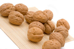 Walnuts. A heap of fresh walnuts. Image isolated on white studio background Stock Photography
