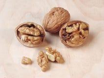 Walnuts. Cracked walnuts stock photos