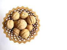 Walnuts. In the  cedar vase  on   white background isolated Royalty Free Stock Photos