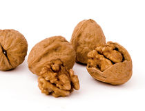 Walnuts. Five walnuts on white background Stock Images