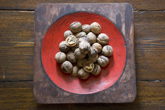 Walnuts. Pile of walnuts on wood table Stock Photography