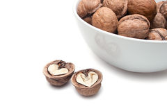 Walnuts and abstract hearts Royalty Free Stock Photo