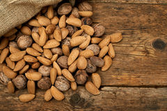 Walnuts and almonds in a burlap bag Stock Photography
