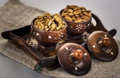 Walnuts and almonds in a wooden bowl and tray. Very good for health Royalty Free Stock Image
