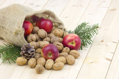 Walnuts and apples Stock Images