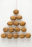 Walnuts arranged in a pyramid shape Royalty Free Stock Photos
