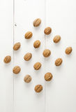 Walnuts arranged in a symmetric rhomb shape Royalty Free Stock Images