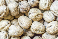 Walnuts. Background of many walnuts. View from above Stock Image