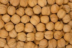 Walnuts background, pile of unshelled nuts stock photos