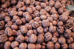 Walnuts. A background of walnuts sold in a marketplace Stock Photography