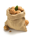 Walnuts in bag on white background Royalty Free Stock Photography