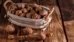 Walnuts in a basket stock images