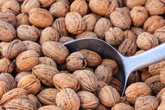 Walnuts in a basket and a shovel Royalty Free Stock Images