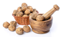 Walnuts in a basket and a wooden mortar Royalty Free Stock Photos
