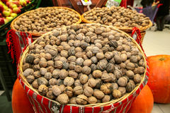 Walnuts in baskets Stock Photos