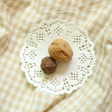 Walnuts on beige check background. Top view Royalty Free Stock Photo