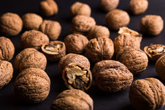 Walnuts on a black background Stock Image