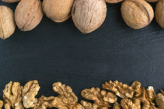 Walnuts on a black background. Close-up, text Royalty Free Stock Images