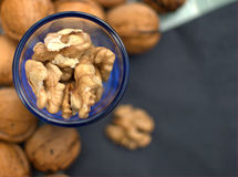 Walnuts in blue glass Royalty Free Stock Image