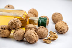 Walnuts and a bottle oil of nut Stock Photos
