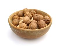 Walnuts in a bowl, isolated on white Stock Image