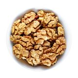 Walnuts in bowl isolated on white. Background royalty free stock image