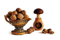 Walnuts in the bowl and nutcracker Stock Images