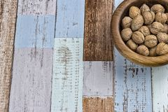 Walnuts in a bowl. On rustic background. Top view Royalty Free Stock Photo