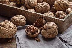 Walnuts in a box on the table. Royalty Free Stock Photos
