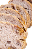 Walnuts bread. Some slices of walnuts bread on a white background royalty free stock photography